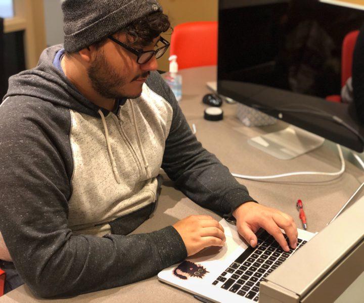 Eric Chavarria works on code.